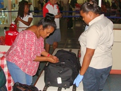 Inspecting passenger baggage for biosecurity risk material